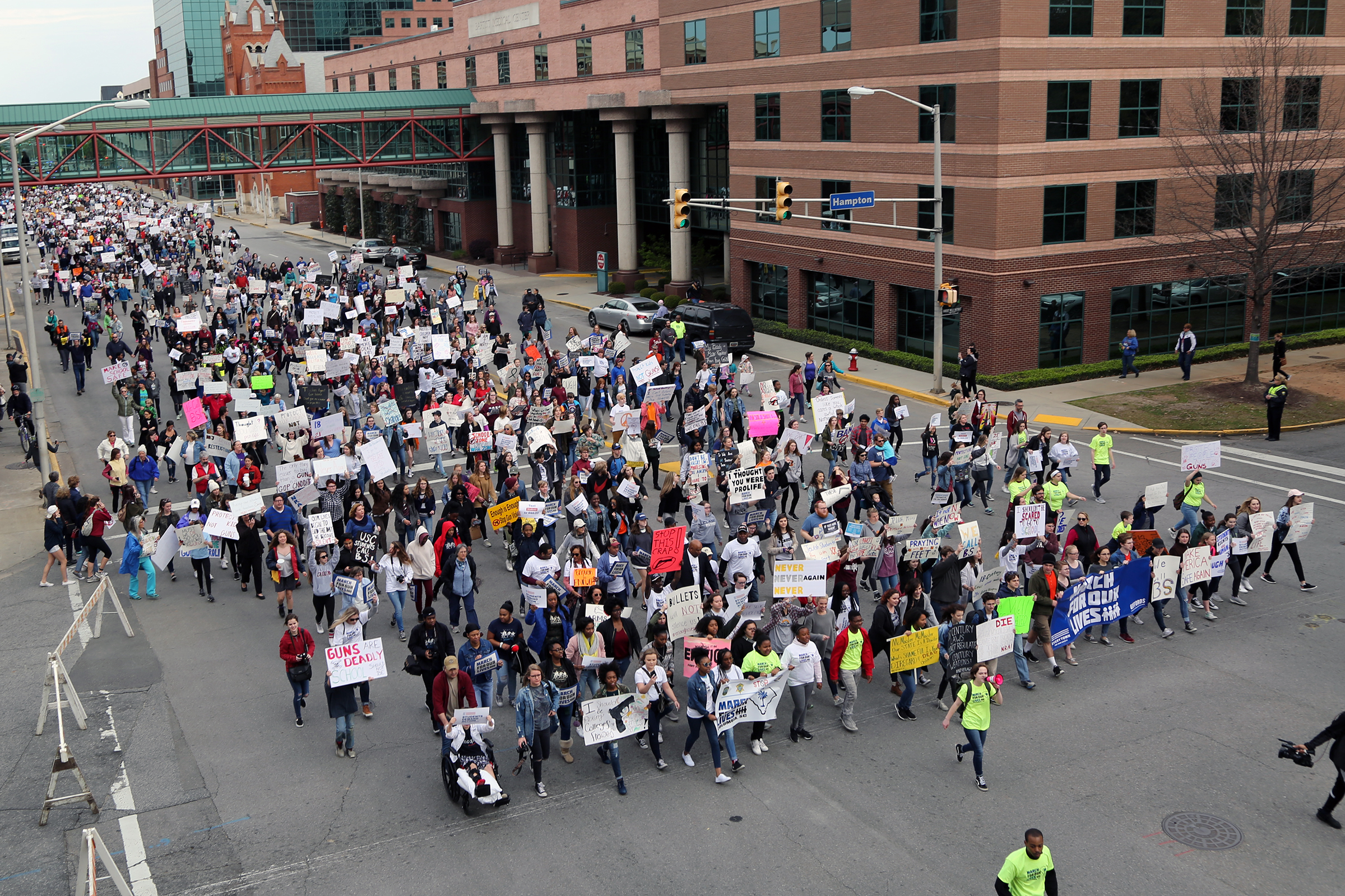 The mile-long March For Our Lives in Columbia took just 14 minutes, leaving journalists and photographers running to stay up.