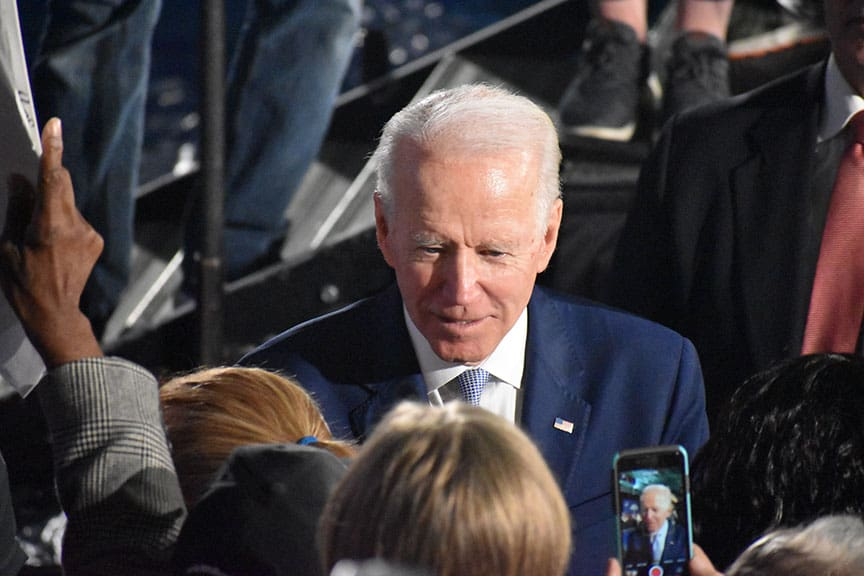 Joe Biden visits with supports and takes photos.