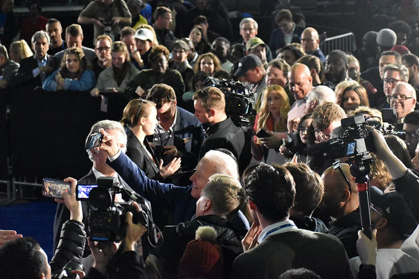 Joe Biden, bottom center takes photos with a ring of supporters after his victory in South Carolina's democratic primary.